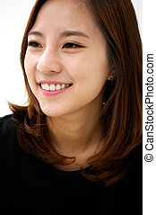Friendly Smile - Closeup portrait of gorgeous young asian...