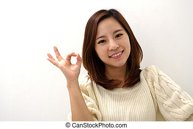 Beautiful female giving okay sign - Beautiful female giving...