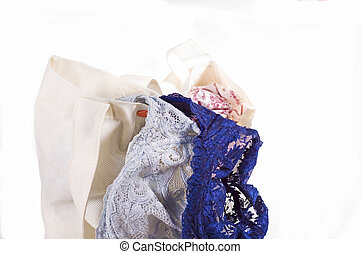 lacy bra falling out of a bag - blue lacy bra on the white...