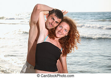 Happy couple in love - Young happy couple in love having fun...