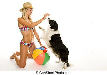 bikini - beautiful isolated woman with bikini is playing...