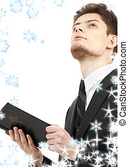 man with holy bible - picture of man with holy bible and...