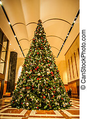 decorated christmas tree indoor - This dramatic image is of...