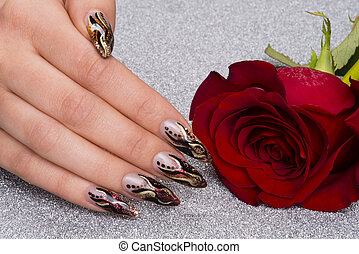 manicure - beautiful hand with fresh manicured stylish nails