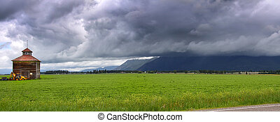 Farm landscape - Panoramic view of farm landscape and stormy...