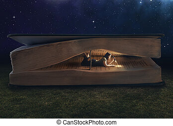 Woman reading inside a huge book