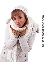 Young african american woman wearing winter clothes