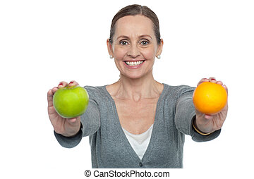 Eat healthy fresh fruits and stay fit - Woman on a diet with...