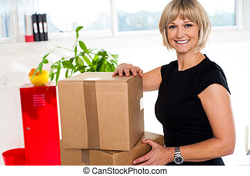 Blonde woman is ready to unpack her office stuff - Helper...