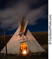 Teepee - Traditional North American Teepee. Illuminated by...