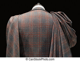 Mannequin in checkered suit with fabric folds - Rear close...