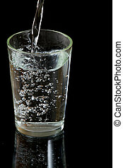 Glass of water - Pouring fresh cold water into the glass