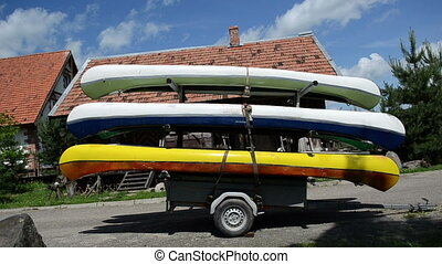 canoes boats trailer - kayaks canoes boats loaded on special...