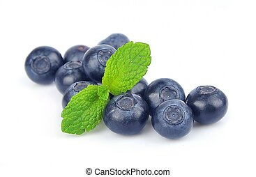 Blueberries with mint leaves on white