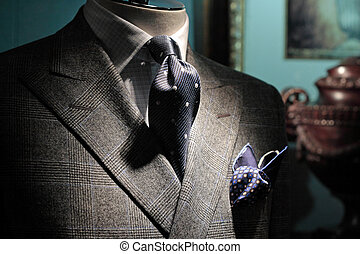 Grey checkered jacket, dark blue tie and handkerchief Grey...