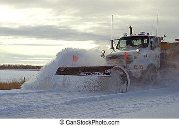 Snow plow after winter storm - Snow plow in early morning on...