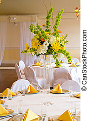 Wedding Reception - Place settings, tables, and chairs are...