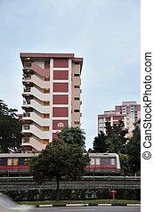 Singapore train zooms past building - A Singapore subway MRT...