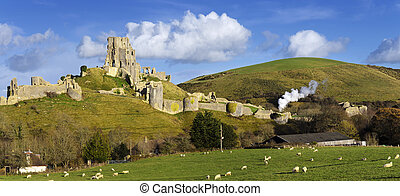 Corfe Castle - The ancient ruins of Corfe Castle near...
