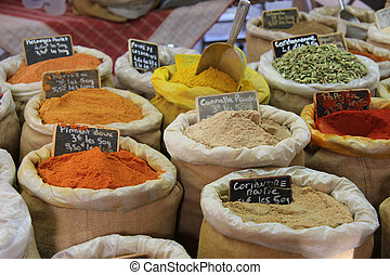 Herbs and spices at a french market - Herbs and spices in...