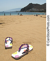 Flip-flops in the sand of Teresitas beach. Tenerife island,...