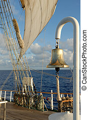 Details of a sailing ship on the background of the ocean