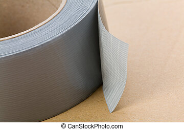 Grey Duct Tape  - a roll of Grey Duct Tape close up shot