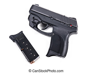 9mm Handgun & Magazine - 9mm Handgun isolated with a filled...