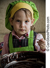 Child Chef Preparing and Eating Dessert - Cute 4 years old...