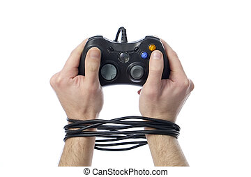 videogame addiction - wired hands with joypad meaning...