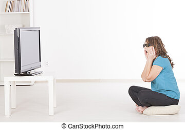 woman watching 3D TV in glasses