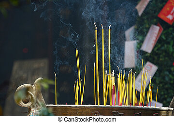 Incence Sticks - Smoking prayer sticks at asia pagoda