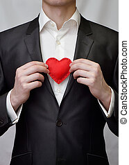 Guy with red decorative heart - The guy holding a red...