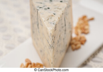 gorgonzola cheese fresh cut and pinenuts - piece of Italian...