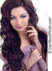 Glamour portrait of beautiful woman with beauty long brown hair - posing at studio