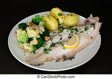 Dover sole fish dinner with potatoes, broccoli (romanesco...
