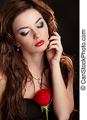 Elegant woman with red rose. Glamour portrait of female...