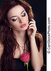 Beautiful brunette woman with rose flower. Glamour portrait...