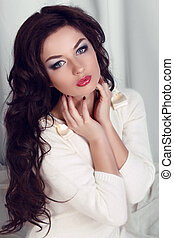 Woman with beauty long brown hair - posing at home studio