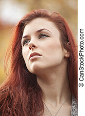 Young Woman with Beautiful Auburn Hair - Young woman staring...
