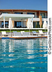 Swimming pool with jacuzzi by beach at the modern luxury hotel, Pieria, Greece