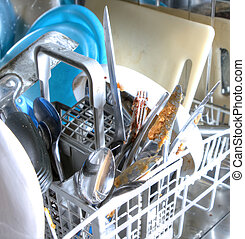 inside of as dishwasher containing dirty dishes