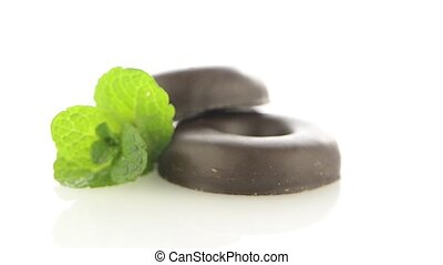 Chocolate donut cookies rotating on white background
