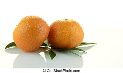 Tangerines rotating on white background
