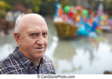 The elderly man in park The lake