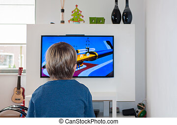 Little child watching HD TV - Little child watching a...