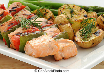 Salmon Kabobs - Grilled salmon kabobs served with vegetables...
