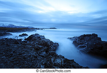 Tranquil sea in south east iceland - twilight coast in the...