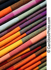 Table Cloths in Otavalo - A stack of colorful handmade table...