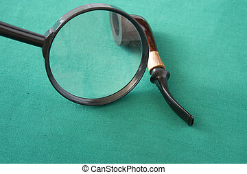 magnifying glass and pipe